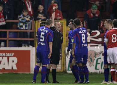 Rovers' Mark Quigley is shown a red card.
