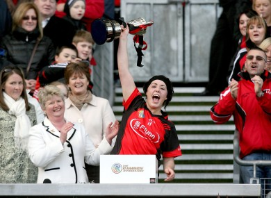 Oulart-the-Ballagh's Una Leacy lifts the trophy.