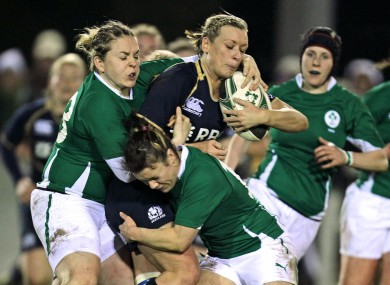 Ireland's Niamh Briggs and Lynne Cantwell tackle Laura Steven of Scotland.