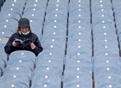 A spectator studies her programme before the Dublin v Cork game yesterday.