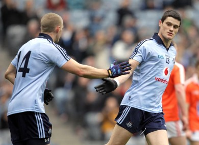 Eoghan O'Gara, left, celebrates the game's first goal with scorer Diarmuid Connolly.