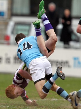St. Michael's Jack Kelly is sent off for this tackle on Conor Murray of Clongowes.