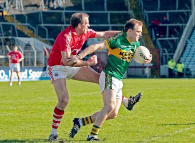 Cork's Paudie Kissane challenges Darran O'Sullivan of Kerry.