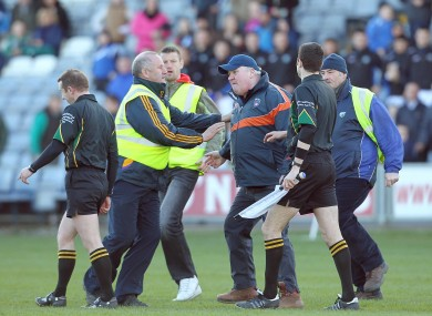 Armagh Assistant manager Paul Grimley confronts referee Michael Duffy after Sunday's game.