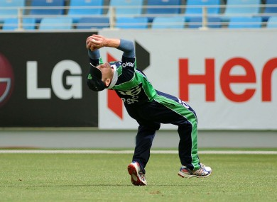 William Porterfield makes a catch to dismiss Stephen Myburgh of The Netherlands.