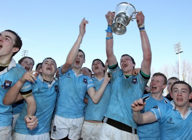 St Michael's players celebrate their Junior Cup win at Donnybrook yesterday.