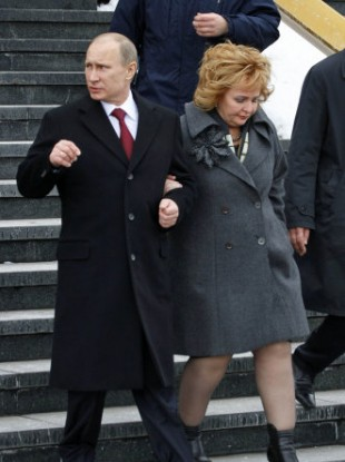 Putin leaves a polling station earlier today with his wife Lyudmila.