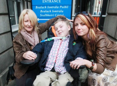 Cullen Kennedy outside the High Court today, with his grandmother Monica (left) and mother Margaret (right).