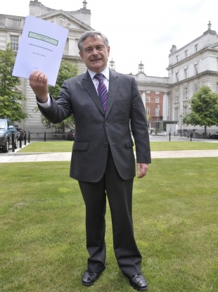 Labour Party Minister Brendan Howlin with the First Progress Report of the Implementation Body on the Croke Park Agreement.