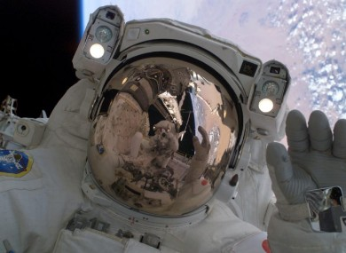 Discovery astronauts carry out a spacewalk in 2005.