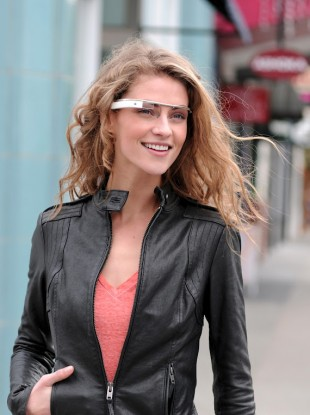 A model casually wearing this summer's augmented reality glasses trend.