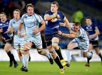 Jamie Heaslip surges past Richie Rees of Cardiff