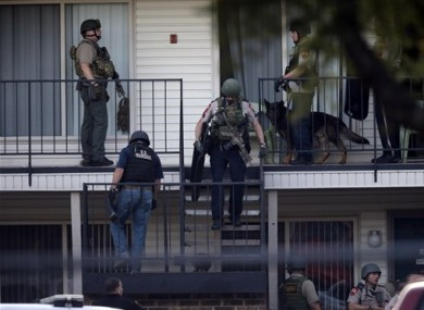 Police at an apartment near the scene of the kidnapping.