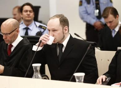 Anders Behring Breivik sits between his defence lawyers during his trial