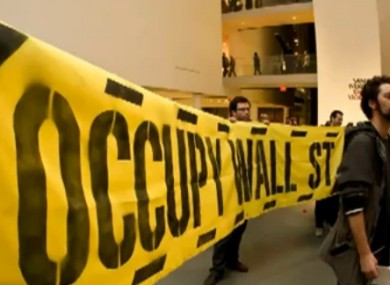 Banner held by Occupy Museum protester