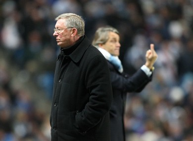 Face off: Alex Ferguson and Roberto Mancini.
