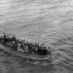 Survivors aboard a collapsible life-boat from the Titanic, seen here as the boat rowed slowly towards the RMS Carpathia immediately before the rescue of the passengers. (Topham/Topham Picturepoint/PA Images)