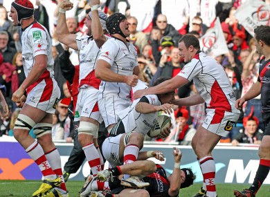 The Ulster players celebrate Pedrie Wannenburg's try.