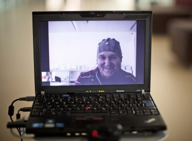 Mark-Andre Duc, a partially tetraplegic patient, is seen on a laptop screen as he talks to scientists in Switzerland's Federal Institute of Technology in Lausanne, Switzerland, Tuesday, April 24, 2012