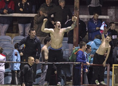 Soak it up: Drogheda fans celebrate their win against Derry.