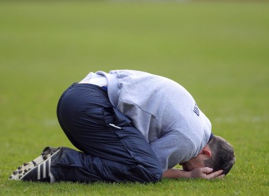 Clare manager Davy Fitzgerald sinks to his knees to celebrate yesterday's win in the Division 1B final.