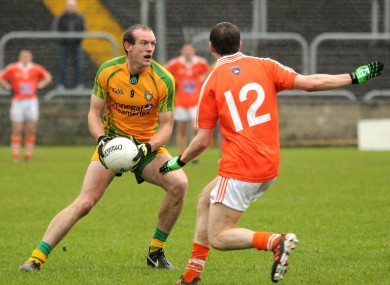 Donegal's Neil Gallagher with Anto Duffy of Armagh.