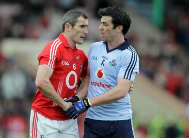 Cork's Graham Canty with Michael Darragh MacAuley of Dublin at the end of the game.