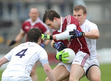 Nicky Joyce, centre, is tackled by Ollie Lyons and Peter Kelly of Kildare.
