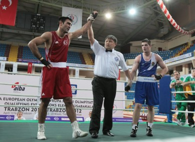Muzaffer, left, is declared the winner against Ireland's Joe Ward.