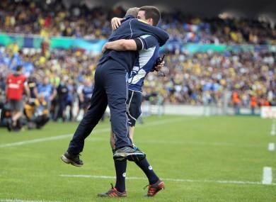 what it feels like to win in France. Joe Schmidt embraces Jonathan Sexton.