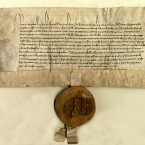 Irish chancery letters dated 23 May 1398 granting a licence to William FitzWilliam to grant Margaret Topp an annual rent. A fragment of the wax impression of the great seal of Ireland is attached to the letters by a parchment tongue. The seal shows King Richard II (1377-1399) enthroned.