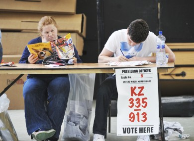 Presiding Officer Sinead Magee and Conor O'Higgins wait for voters at Shankill.
