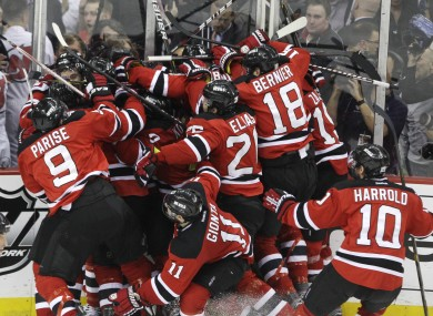 The Devils swarm all over the matchwinner after they bested New York.