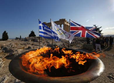 The cauldron with the Olympic Flame is seen atop the Athens Acropolis yesterday.