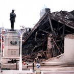 1987: The Cenotaph at Enniskillen with the devastated community centre in the background. 11 people died and more than 50 were injured in a massive IRA bomb explosion just before a Remembrance Day ceremony took place in the Co. Fermanagh town of Enniskillen.   Image: Press Association
