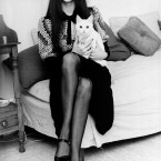 Victoria Principal - later known to us all as Pamela in Dallas - with her cat Motza at her Chelsea flat in London in 1970 when she was just 20. (AP Photo/Press Association Images)