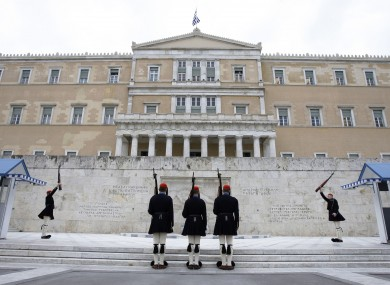 Soldiers perform the changing of the guard outside the Greek presidential palace.