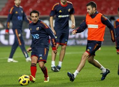 File photo - Xavi and Cesc in training