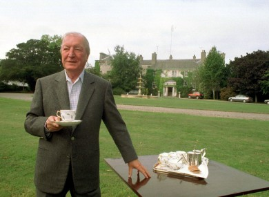 Charlie Haughey with a cup of tea outside his north Dublin mansion in 1995