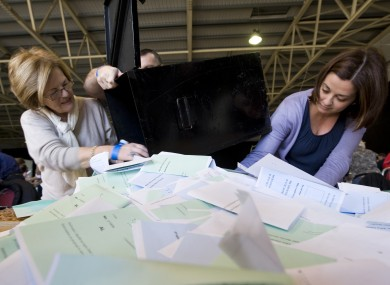 Polling staff open the ballot boxes for the count at last year's presidential election.