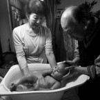 Baby Atlas is given bath by his grandparents.  Image: Sfukada