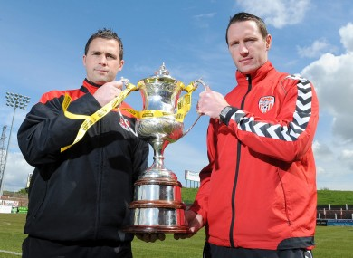 Derry City's Barry Molloy and Crusaders' David Rainey with the Setanta Cup yesterday.