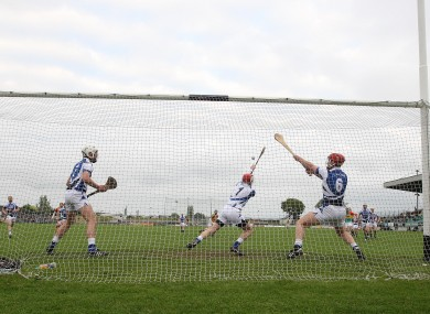 Laois keeper Eoin Reilly saves a penalty against Carlow.