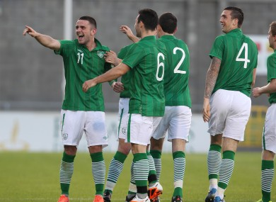 Robbie Brady (left) celebrates scoring during the Ireland U21s' 2-1 defeat to Denmark in Tallaght last night.