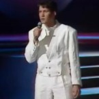 In 1987 Johnny did the double as a performer at the Eurovision in Belgium. Hold us now Johnny, hold us now.   Image: via Hall3010 on YouTube