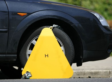 Stock image of a car and wheel clamp