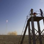 Cameramen film as the Soyuz TMA-04M spacecraft carrying the International Space Station crew blasts off from its launch pad at Baikonur cosmodrome, 15 May 2012.   Image: Shamil Zhumatov