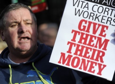 A protester shows support for the Vita Cortex workers at a public rally at Leins