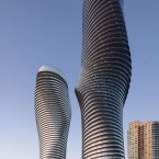 "Dubbed the ""Marilyn Monroe"" building, due to its sexy curves, Absolute Towers has added a new landmark to the skyline of Mississauga, the fast-growing suburb of Toronto. The architects sought to add to something ""naturalistic, delicate and human in contrast to the backdrop of listless, boxy buildings."" The design features smooth, unbroken balconies that wrap each floor of the building. The torsional form of the towers is underpinned with a surprisingly simple and inexpensive structural solution.  (©TomArban) Architect: MAD Architects"