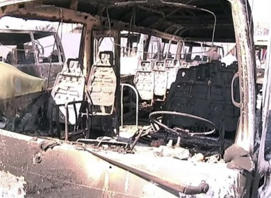 Destroyed buses in Damascus yesterday after fighting in the capital